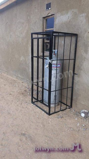 Propane cylinder in cage