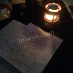 Candle and letter on table